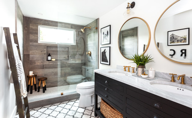 Small cottage multicolored tile and stone tile marble floor doorless shower photo in Sacramento with furniture-like cabinets, black cabinets, a one-piece toilet, white walls, an undermount sink and marble countertops