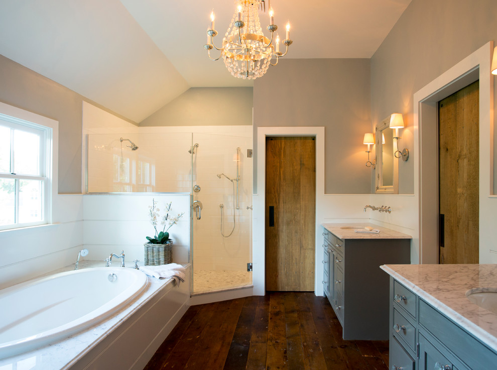 Mid-sized farmhouse master white tile and ceramic tile dark wood floor bathroom photo in Boston with a drop-in sink, marble countertops, gray walls, beaded inset cabinets and gray cabinets
