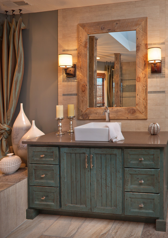 Inspiration for a mid-sized rustic master beige tile beige floor and porcelain tile bathroom remodel in Other with a vessel sink, blue cabinets, shaker cabinets, beige walls and a hinged shower door