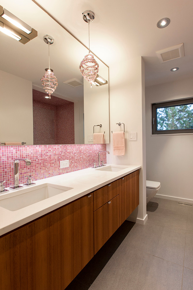 Inspiration for a contemporary pink tile and mosaic tile bathroom remodel in Edmonton with an undermount sink, flat-panel cabinets and medium tone wood cabinets