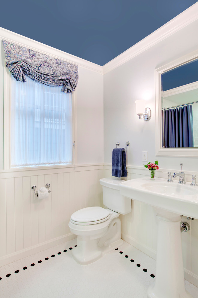 Example of a classic white tile bathroom design in Seattle with a pedestal sink and a two-piece toilet