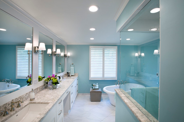 Freestanding bathtub - mid-sized traditional master white tile and porcelain tile porcelain floor freestanding bathtub idea in Wichita with recessed-panel cabinets, white cabinets, a two-piece toilet, blue walls, an undermount sink and engineered quartz countertops