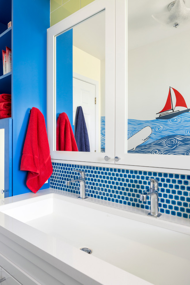Mid-sized beach style kids' blue tile bathroom photo in Seattle with white cabinets, a drop-in sink, quartzite countertops and blue walls