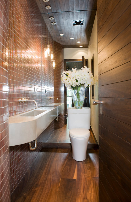 12 design tips to make a small bathroom better for Small toilet design