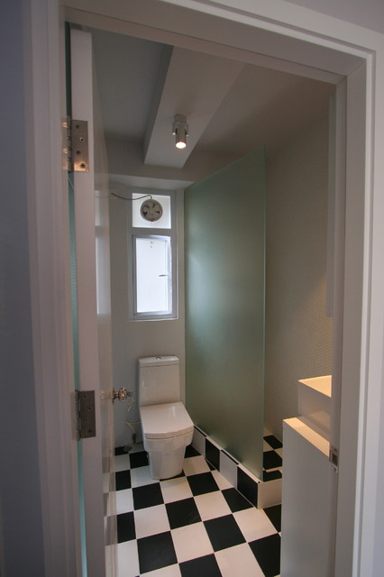 Making 350 square feet spacious and light! eclectic-bathroom