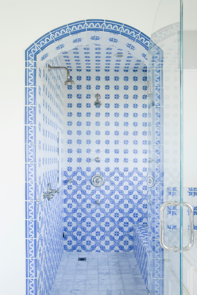 Tuscan blue tile alcove shower photo in Los Angeles with white walls