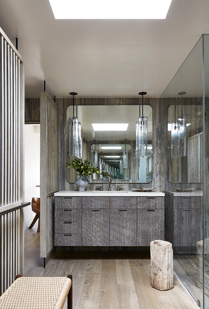 Walk-in shower - contemporary 3/4 light wood floor walk-in shower idea in Los Angeles with flat-panel cabinets, distressed cabinets and an undermount sink