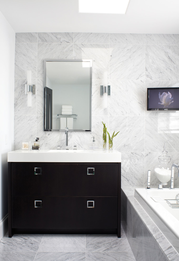Inspiration for a contemporary drop-in bathtub remodel in Other