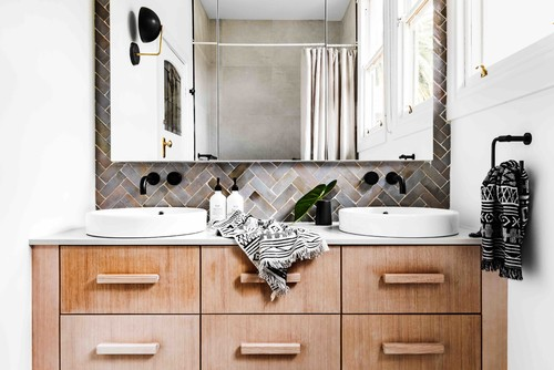 timber vanity with aztec patterned bath towels