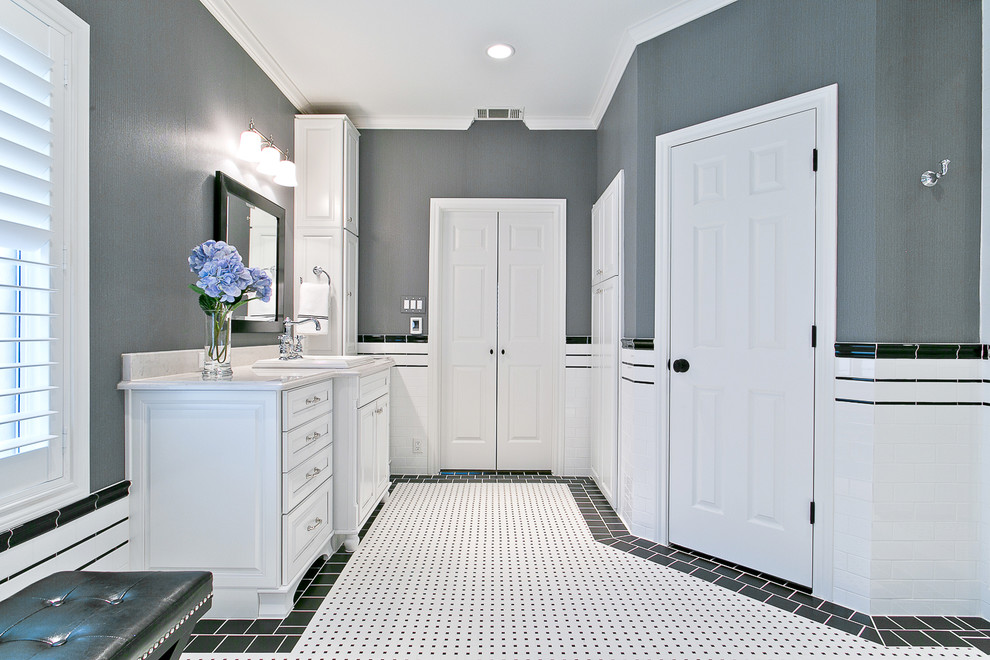 Example of a mid-sized classic master white tile and porcelain tile porcelain tile bathroom design in Dallas with a drop-in sink, furniture-like cabinets, white cabinets, solid surface countertops and a two-piece toilet