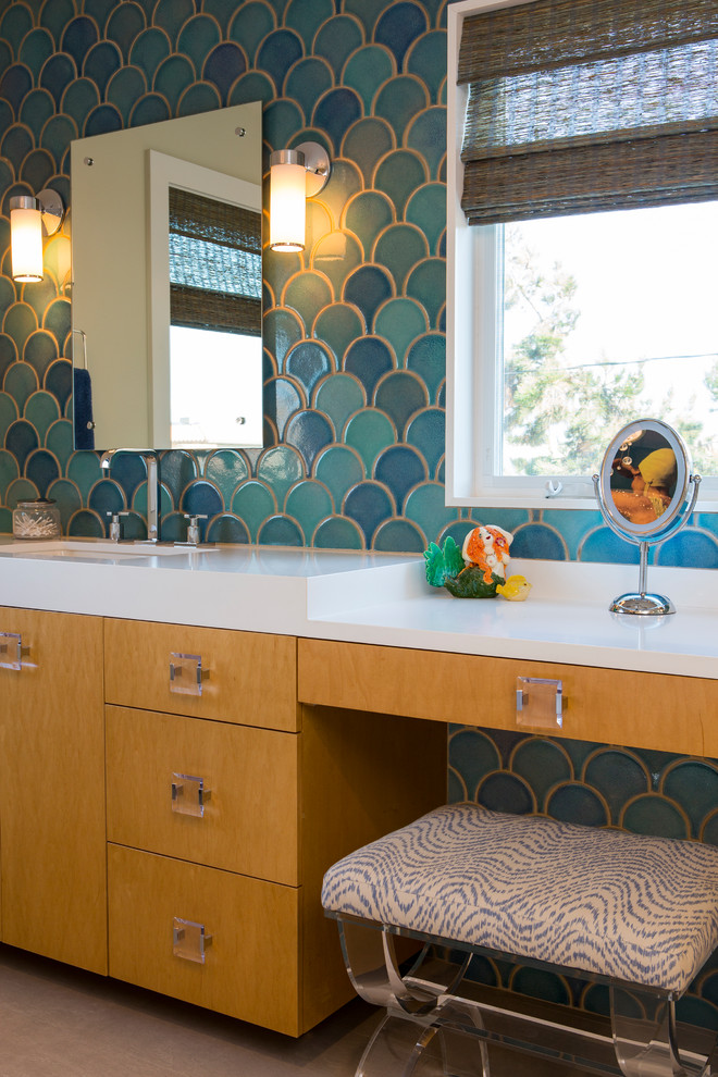 Inspiration for a large transitional master ceramic tile and beige floor bathroom remodel in Los Angeles with flat-panel cabinets, a two-piece toilet, an undermount sink, solid surface countertops, medium tone wood cabinets and blue walls