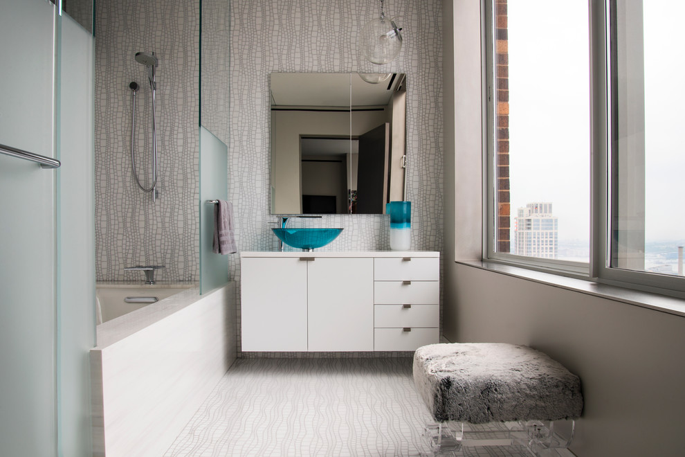 Trendy alcove bathtub photo in New York with a vessel sink, flat-panel cabinets and white cabinets