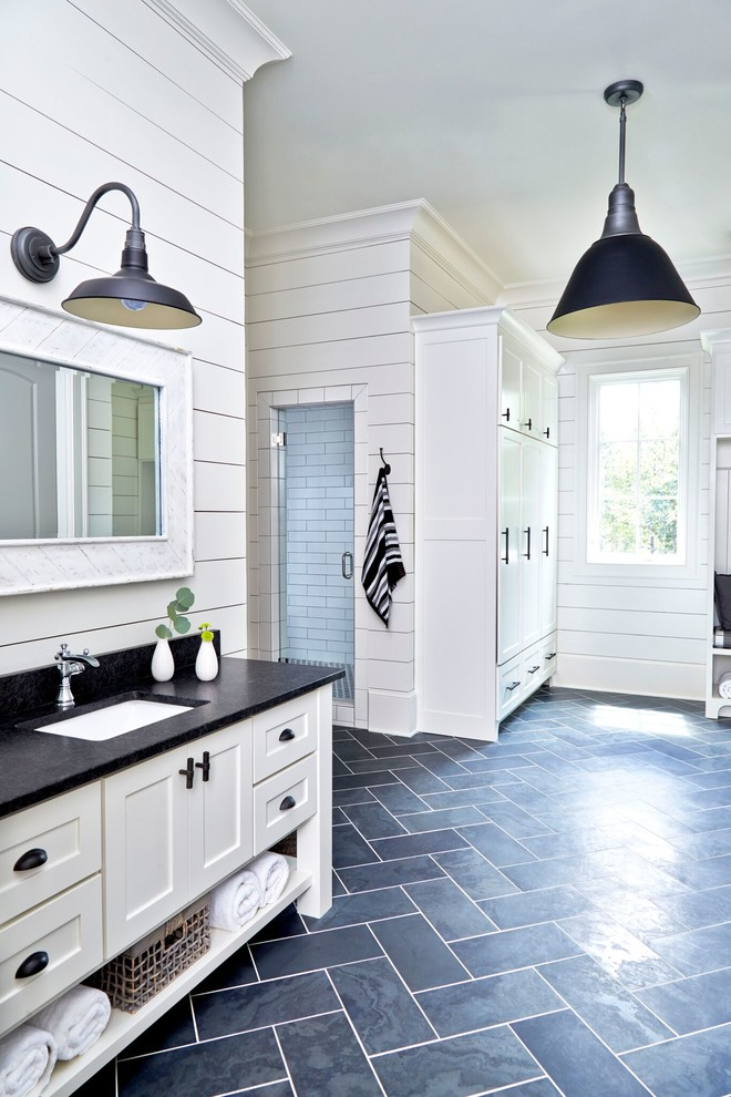 Example of a huge country master black tile and stone tile slate floor bathroom design in Atlanta with shaker cabinets, white cabinets, a one-piece toilet, white walls, an undermount sink and granite countertops