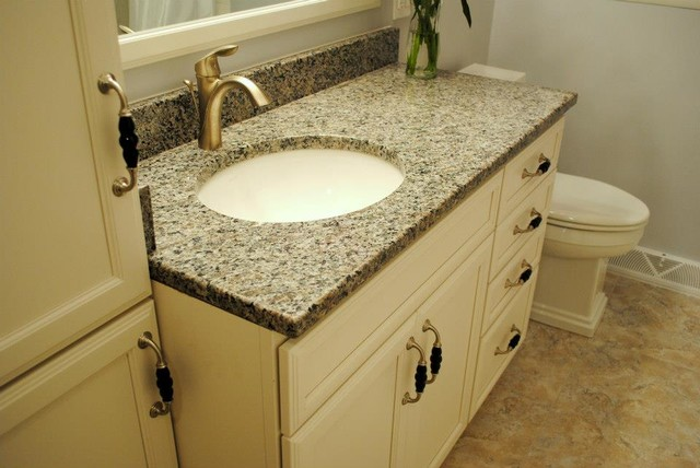 Maple Marshmallow Cream Cabinets, Caledonia Granite, Moen Eva Fixtures  Traditional Bathroom