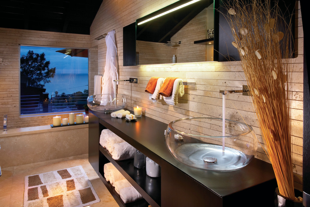 Inspiration for a contemporary beige tile bathroom remodel in Orange County with a vessel sink, open cabinets and dark wood cabinets