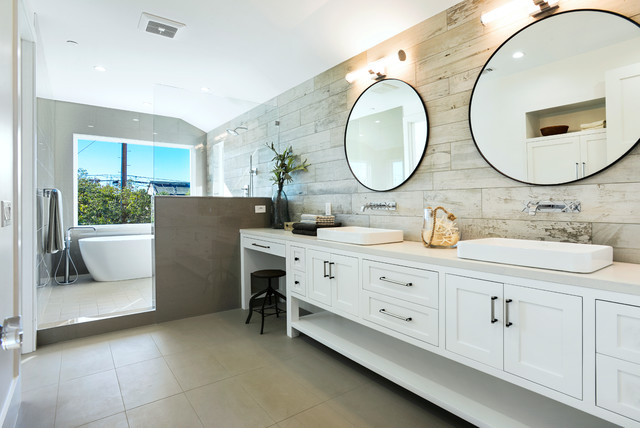 Bathroom - large beach style master porcelain tile and beige tile porcelain floor and gray floor bathroom idea in Los Angeles with shaker cabinets, white cabinets, gray walls, a drop-in sink, engineered quartz countertops, a hinged shower door and gray countertops