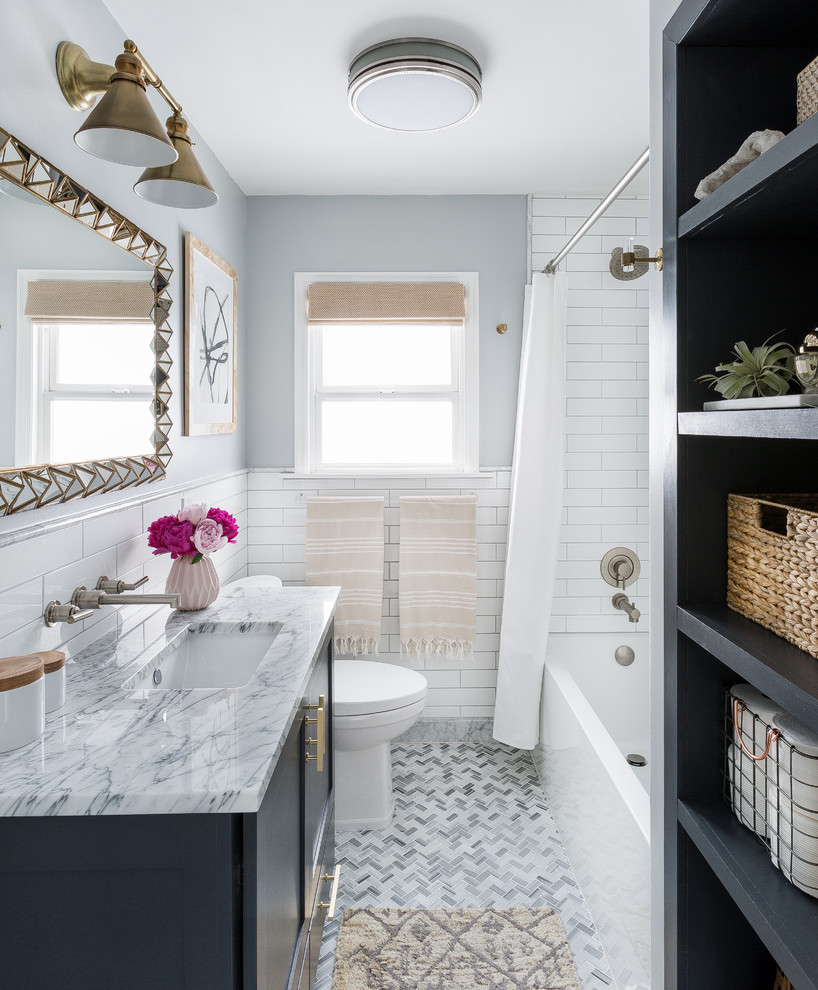 Inspiration for a transitional 3/4 white tile and subway tile marble floor and gray floor bathroom remodel in Seattle with shaker cabinets, black cabinets, gray walls, an undermount sink and marble countertops