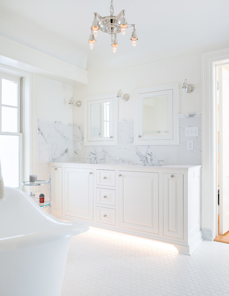 Mid-sized elegant master white tile and porcelain tile porcelain tile bathroom photo in Kansas City with furniture-like cabinets, white cabinets, marble countertops and white walls