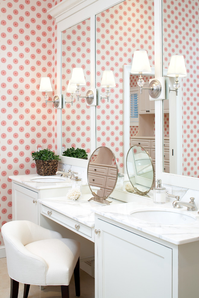 Example of a large coastal master stone tile bathroom design in Boston with marble countertops, an undermount sink, recessed-panel cabinets, white cabinets and pink walls