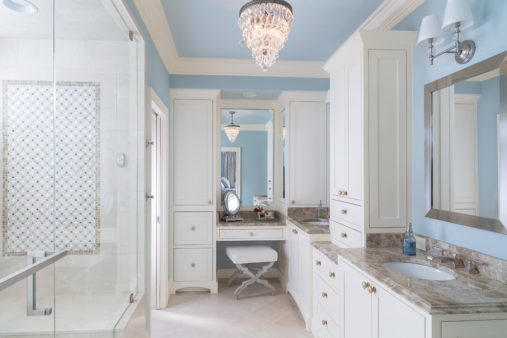 Inspiration for a timeless master stone tile and beige tile marble floor bathroom remodel in Atlanta with an undermount sink, shaker cabinets, white cabinets, marble countertops and blue walls