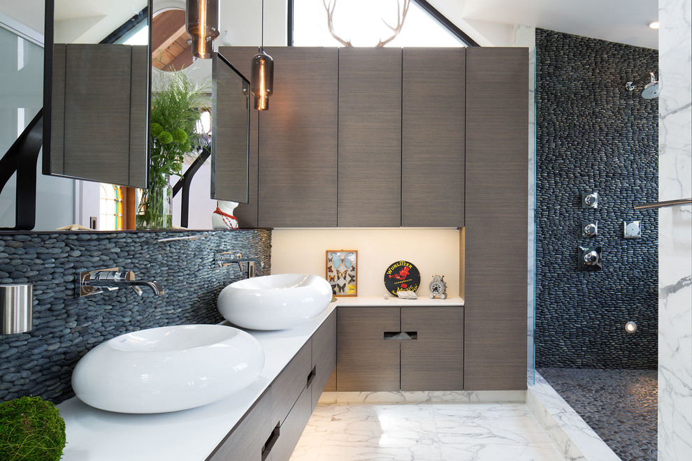 Bathroom - contemporary 3/4 stone tile marble floor and white floor bathroom idea in New York with flat-panel cabinets, brown cabinets, beige walls and a vessel sink