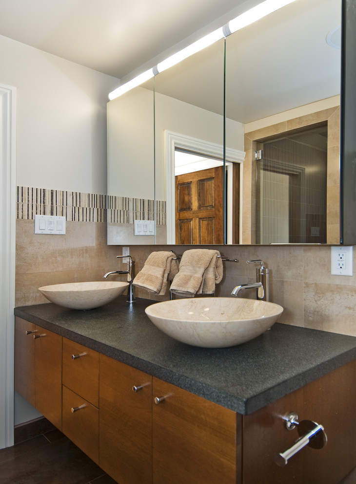 Transitional beige tile bathroom photo in San Francisco with a vessel sink, flat-panel cabinets and medium tone wood cabinets