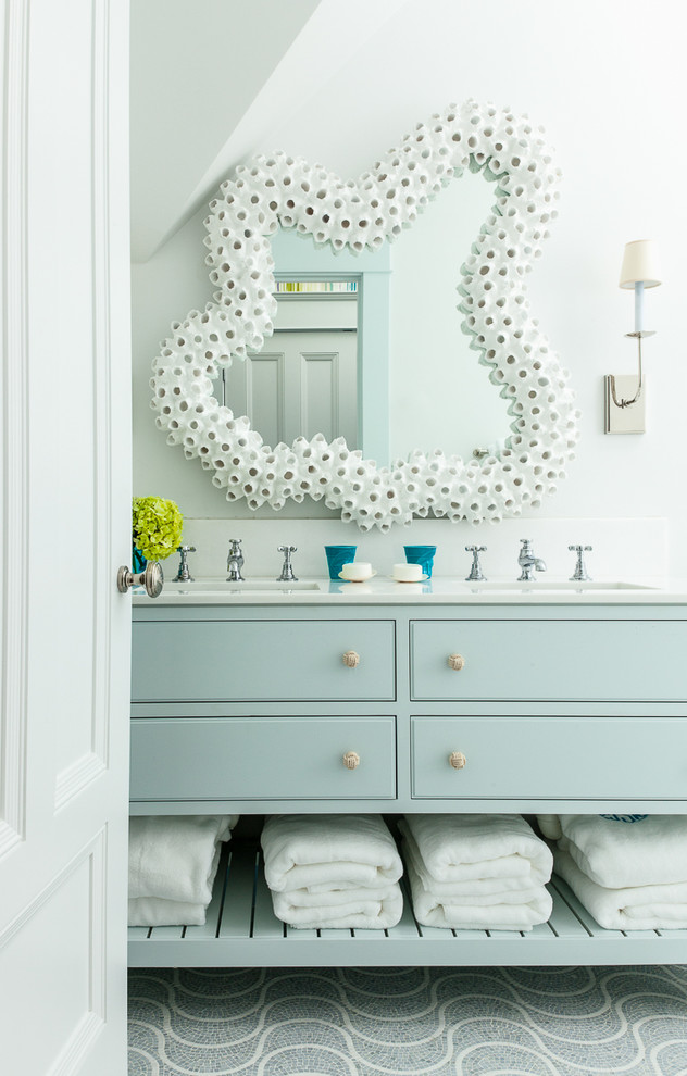 Inspiration for a mid-sized coastal master mosaic tile floor bathroom remodel in Boston with an undermount sink, furniture-like cabinets, blue cabinets, marble countertops and white walls