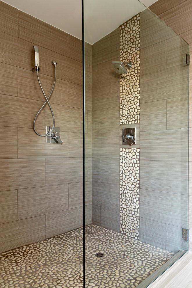 Bathroom - coastal brown tile and pebble tile pebble tile floor bathroom idea in Baltimore