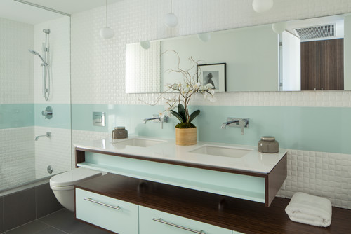 Is this a glass or acrylic splashback between the tiles