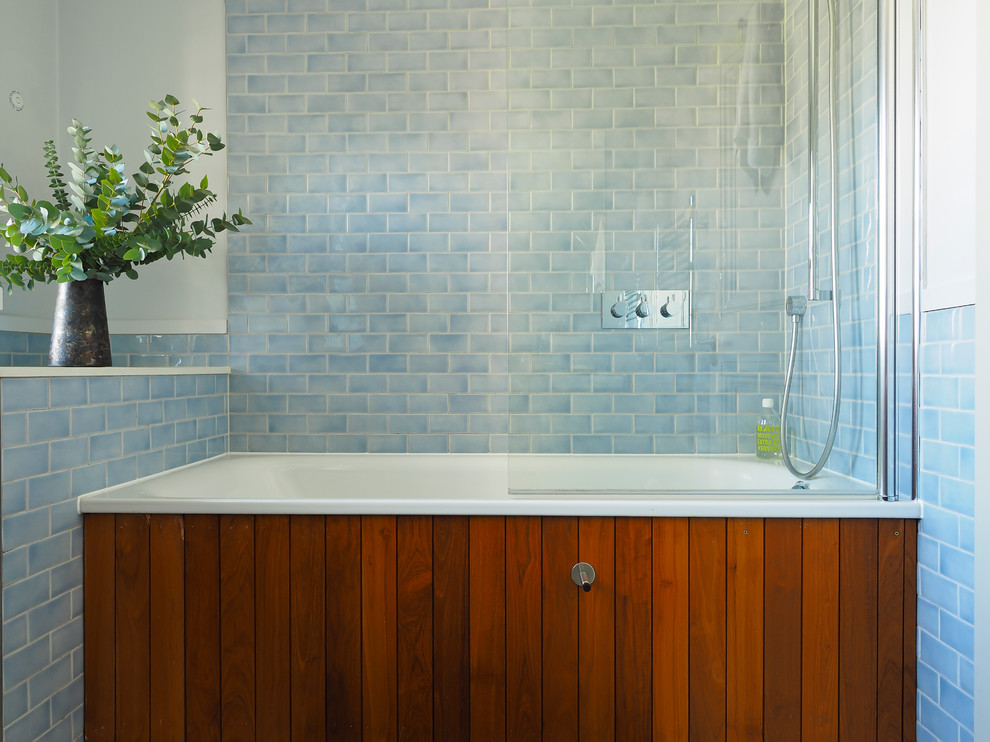 Inspiration for a transitional blue tile and subway tile bathroom remodel in London