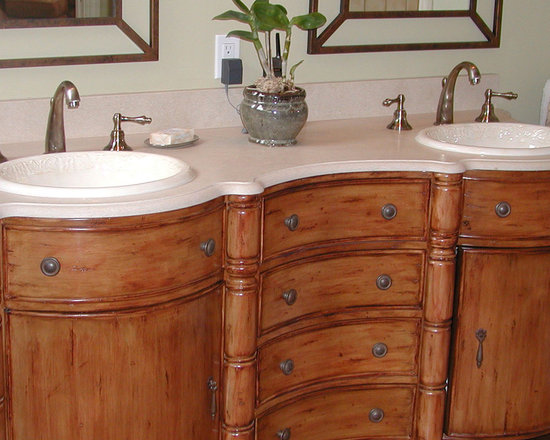 Marzi Sinks at Home - CB-48-100, from Marzi's self rimming collection this oval sink with raised ivy vine is shown in #48 bisque gloss. Photo provided from client. Thank you