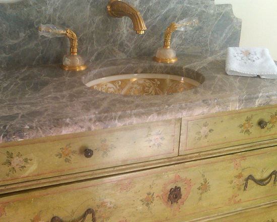 Marzi Sinks at Home - HU-48-600 Baroque Border in Roman Gold. This under mounted oval sink from Marzi has a hand painted Baroque border in Roman Gold. Thank you to our client for providing us with this photo.
