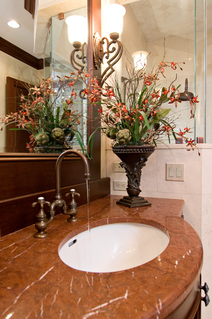 Example of a classic bathroom design in Other with granite countertops and an undermount sink