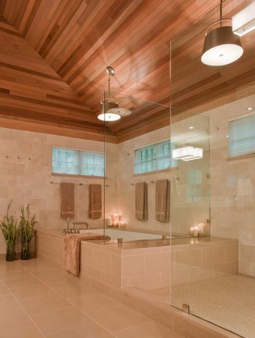 dark wood sloped  ceiling, loft bathroom, light wall tiles, light floor tiles, bathroom tiles, tiles mimic rough stone
