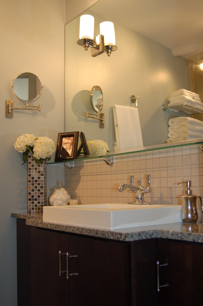 Inspiration for a contemporary bathroom remodel in Chicago with granite countertops