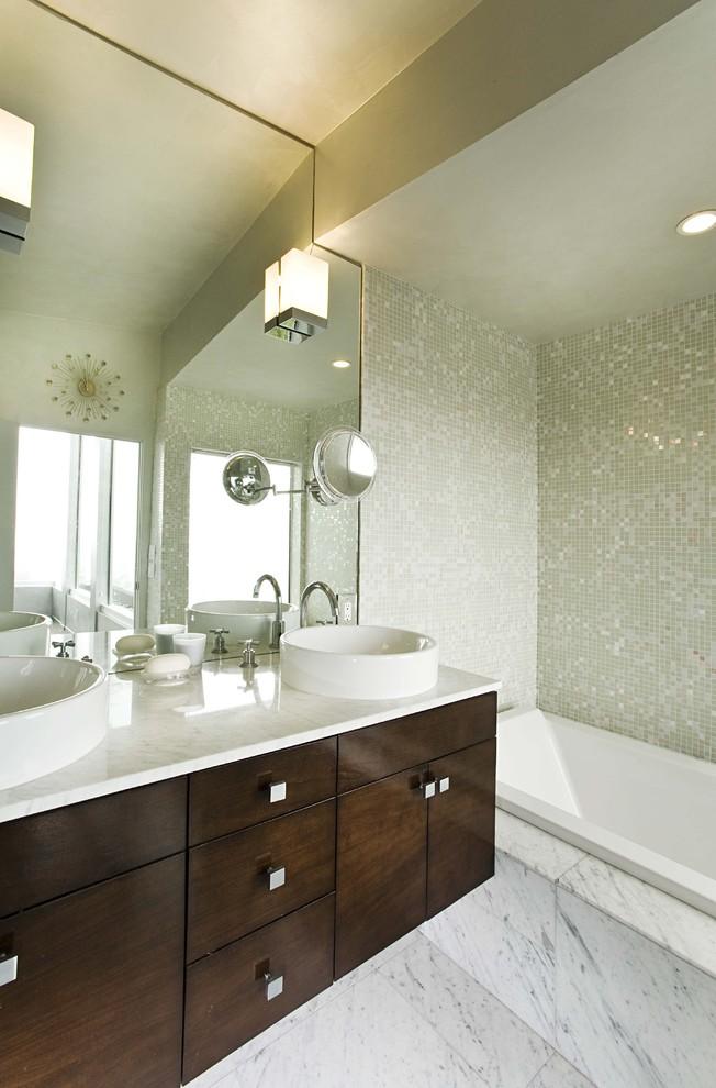 Bathroom - contemporary mosaic tile marble floor bathroom idea in San Francisco with marble countertops and a vessel sink