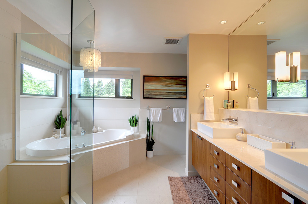 Inspiration for a mid-sized contemporary master beige tile and porcelain tile porcelain floor bathroom remodel in Vancouver with a vessel sink, flat-panel cabinets, medium tone wood cabinets, marble countertops, a one-piece toilet and beige walls