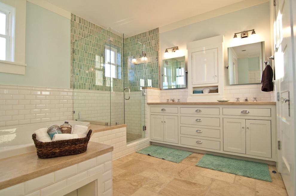 Beach style ceramic tile alcove shower photo in Orange County