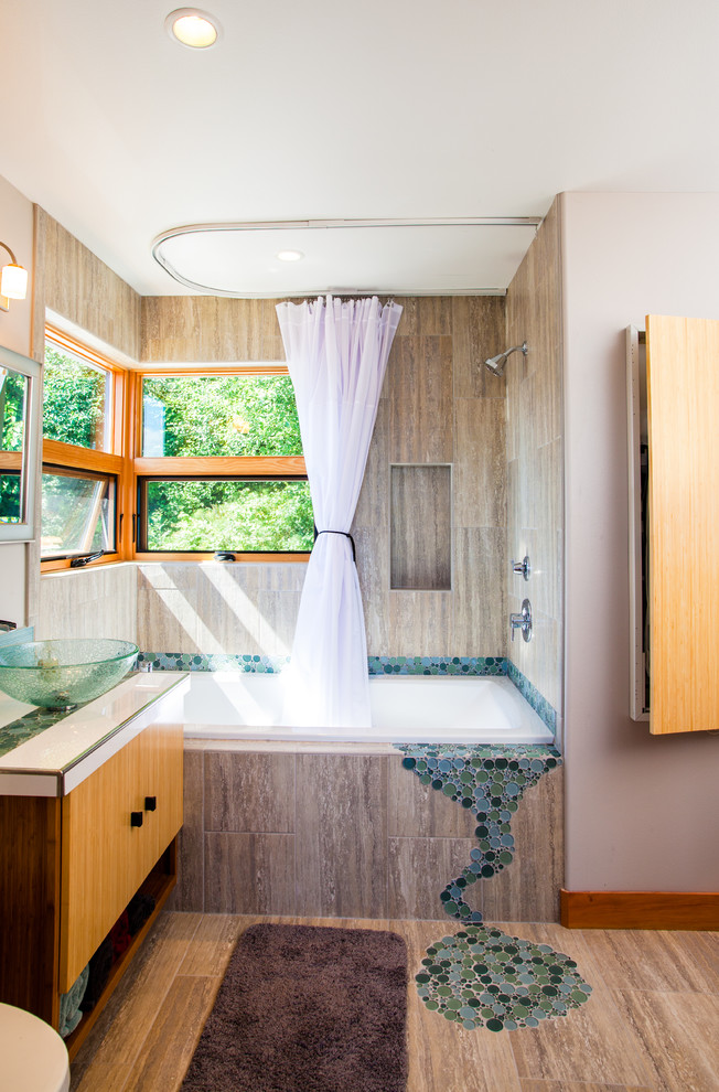 Mid-sized trendy brown tile and porcelain tile porcelain tile and brown floor bathroom photo in Seattle with a vessel sink, flat-panel cabinets, light wood cabinets and beige walls