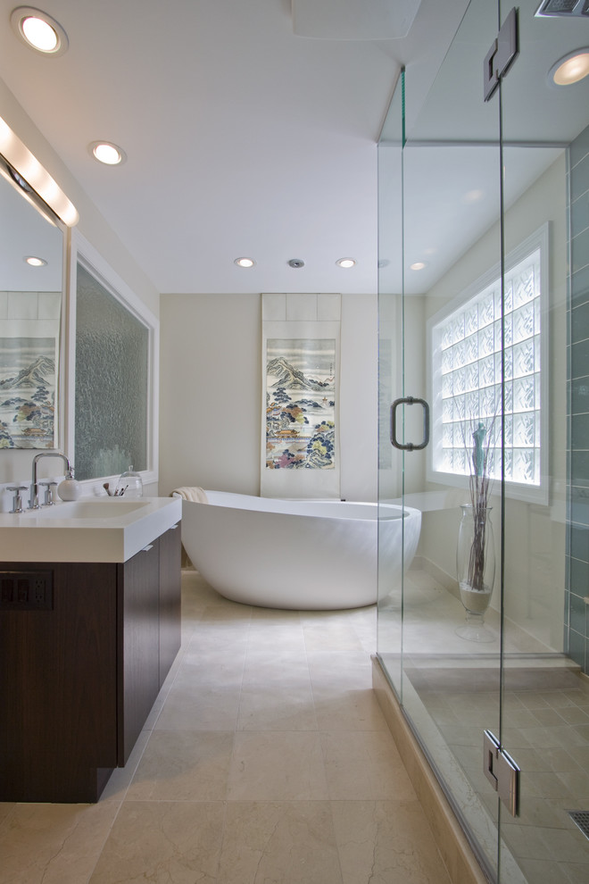 Inspiration for a huge modern master stone tile and beige tile limestone floor bathroom remodel in Minneapolis with an undermount sink, solid surface countertops, white walls and dark wood cabinets