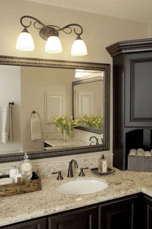 Elegant Traditional Bathroom Featuring A Rectangular Mirror And Bath Bar Above