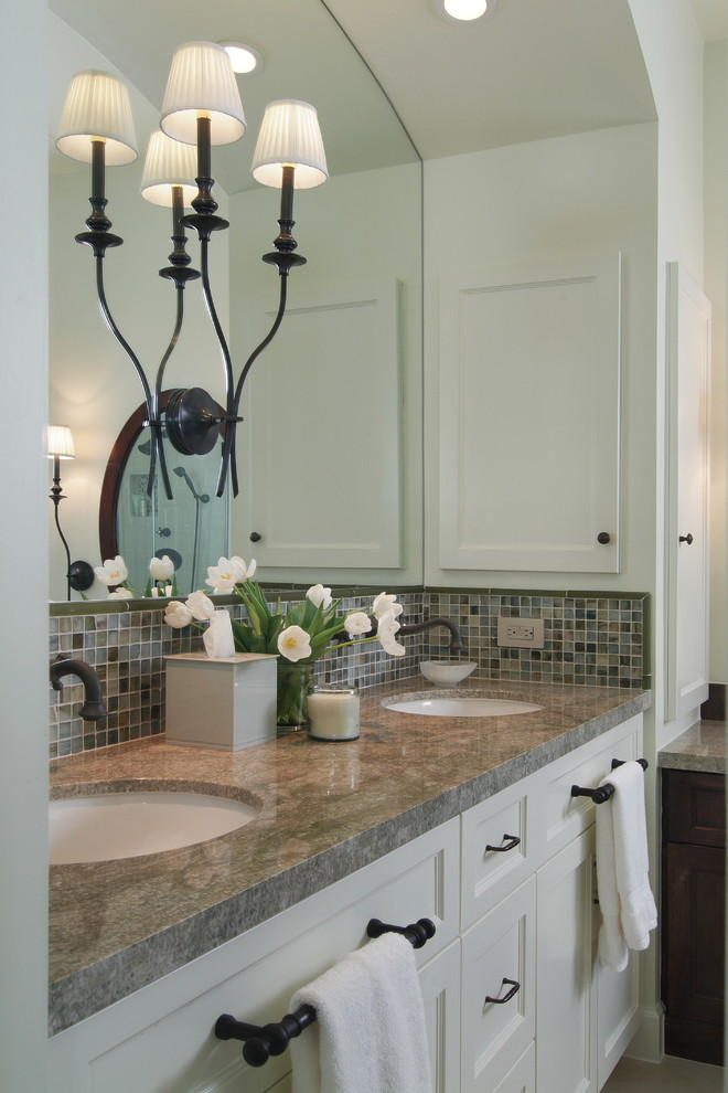 Inspiration for a timeless multicolored tile and mosaic tile bathroom remodel in Houston with an undermount sink, recessed-panel cabinets and white cabinets