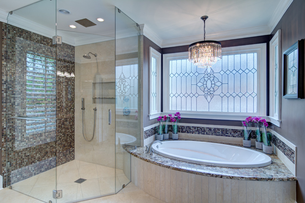 Inspiration for a huge transitional master multicolored tile and mosaic tile porcelain tile bathroom remodel in Atlanta with an undermount sink, raised-panel cabinets, dark wood cabinets, granite countertops and brown walls