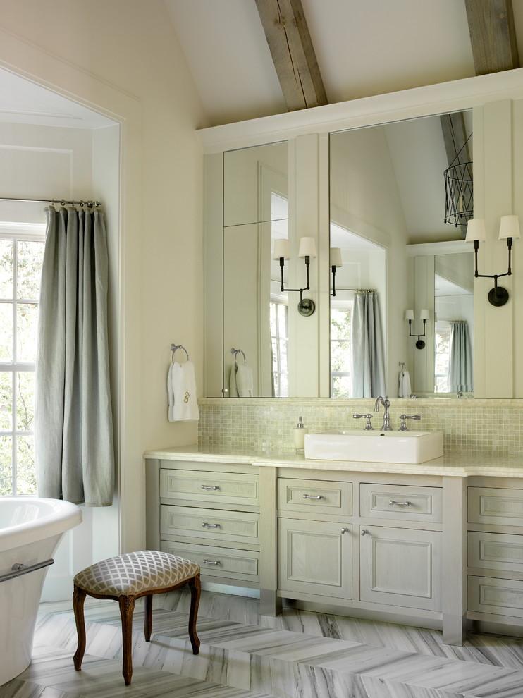 Example of a classic mosaic tile freestanding bathtub design in Atlanta