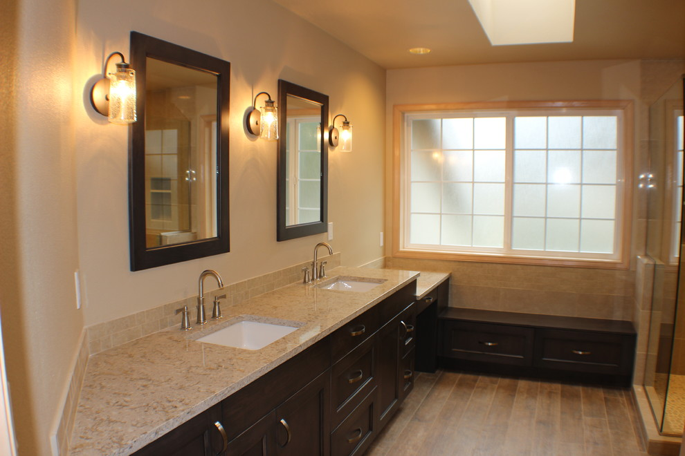 Example of a large mountain style master beige tile and porcelain tile porcelain tile, brown floor and double-sink bathroom design in Other with recessed-panel cabinets, medium tone wood cabinets, an undermount sink, quartz countertops, beige countertops and a built-in vanity