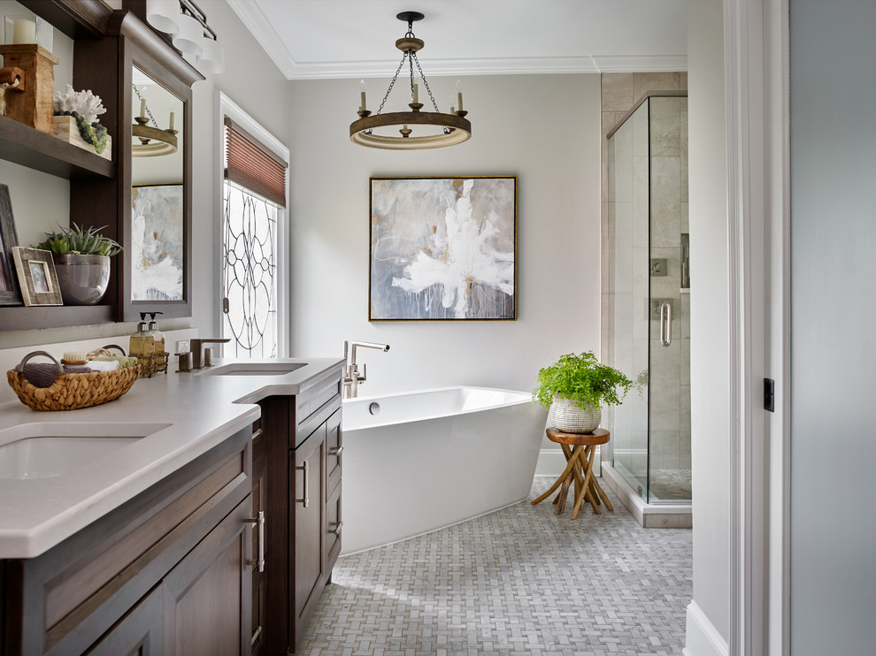 Mid-sized transitional master gray tile and mosaic tile marble floor bathroom photo in Atlanta with raised-panel cabinets, medium tone wood cabinets, a one-piece toilet, gray walls, an undermount sink and quartz countertops