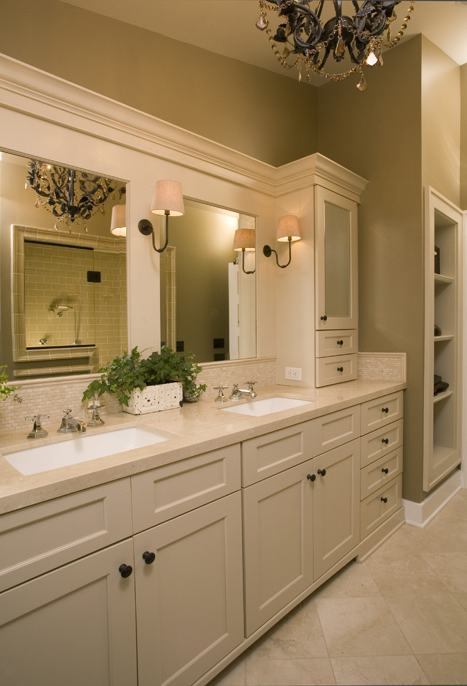 Bathroom - traditional beige tile bathroom idea in Seattle with an undermount sink, shaker cabinets, beige cabinets and beige countertops