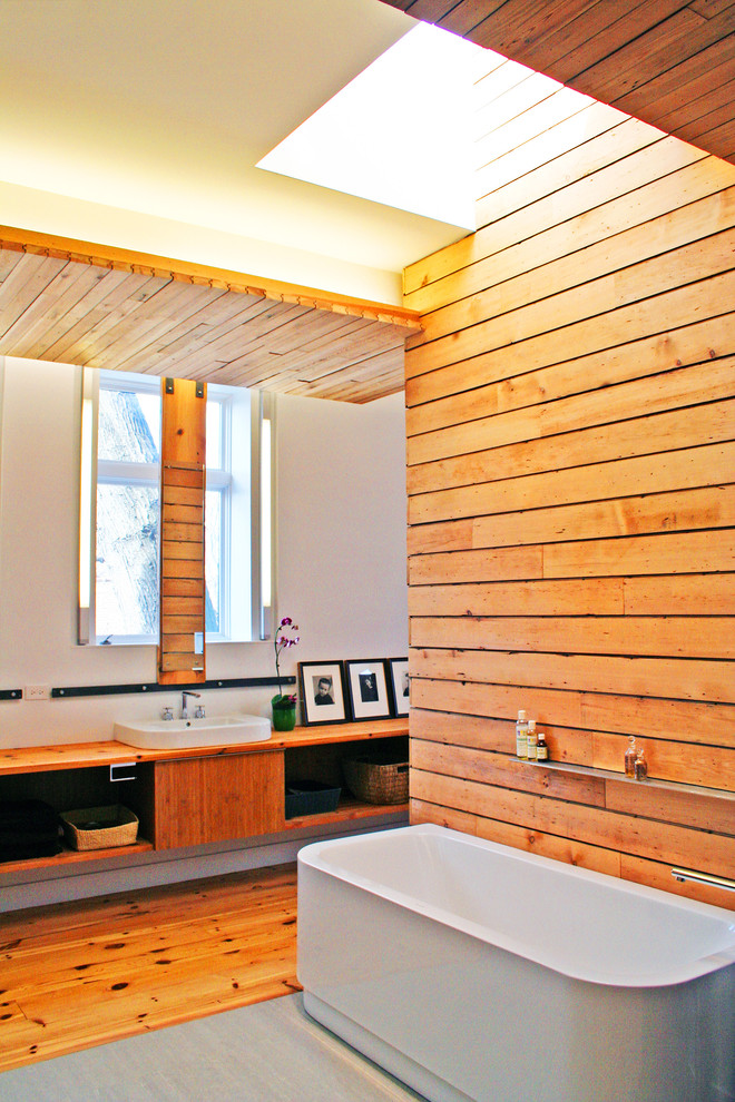 Inspiration for a contemporary freestanding bathtub remodel in Chicago with a vessel sink