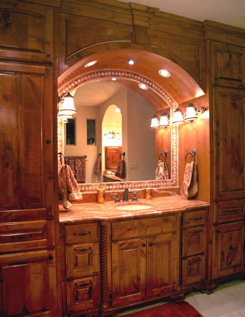 Master bath vanity mediterranean bathroom austin by asomoza homes design build for Mediterranean bathroom lighting