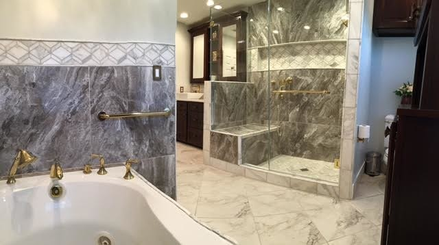 Master Bath w/ custom Mahogany cabinets, large porcelain tiles and marble tiles